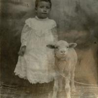 Concha Ortiz y Pino, age 5, with lamb